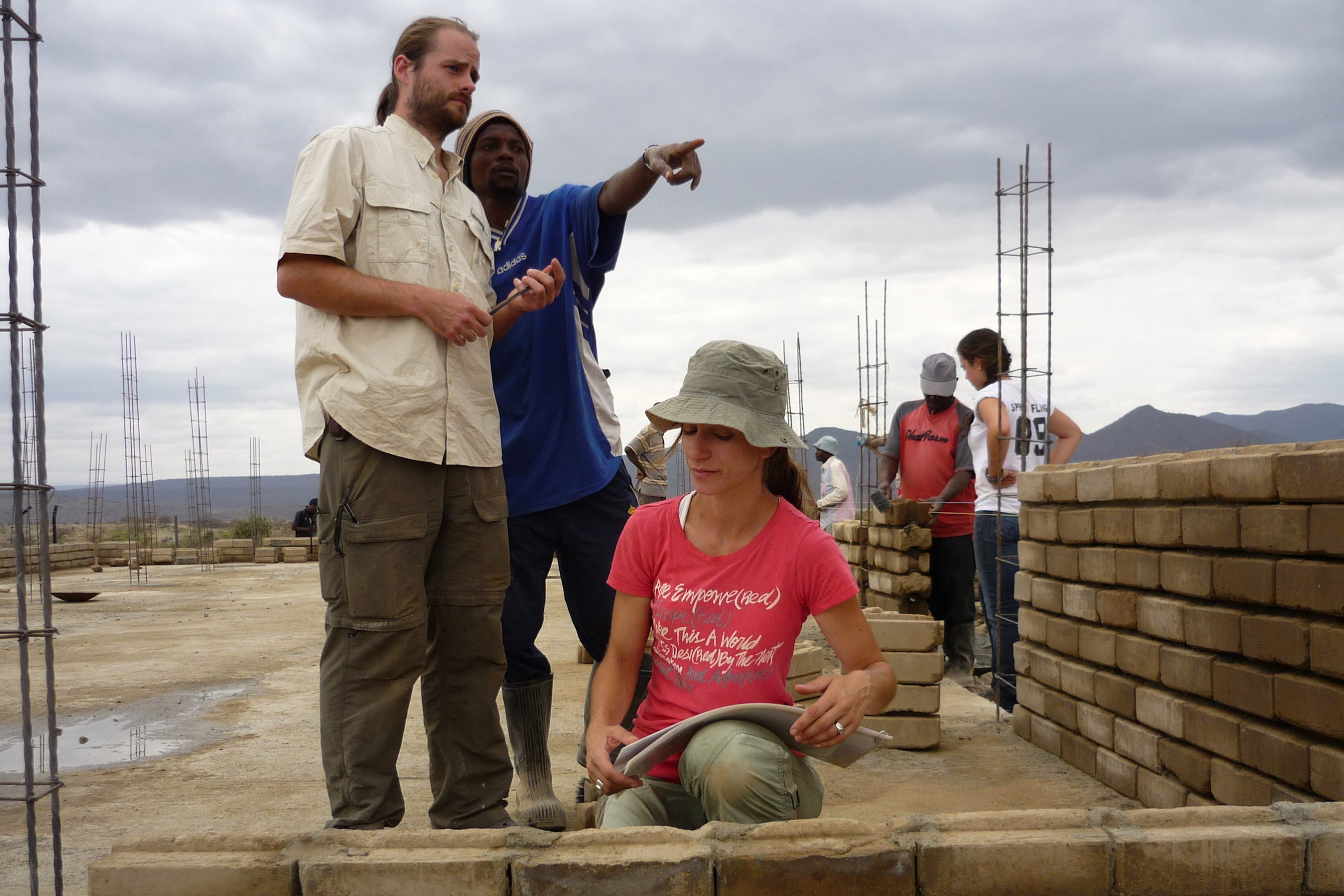 Compressed earth block wall construction in Oloika, Kenya